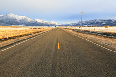Rural road. Through farm fields in Heber Valley, Utah, USA Royalty Free Stock Images