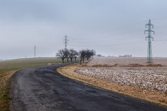 Rural road through a field covered with frost Stock Photo