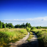 Rural road in field Royalty Free Stock Photos