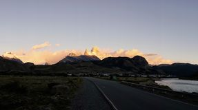 Rural Road and Fitz Roy Mountain at Dusk. Rural road and the famed Fitz Roy mountain at dusk. Diminishing perspective. Panorama Stock Photography