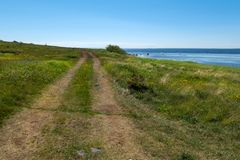 Along the seashore. Rural road - the gauge goes along the White Sea on Anzersky Island stock photography