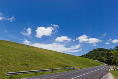 Rural road with green grass Royalty Free Stock Images
