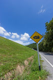 Rural road with green grass Stock Photo