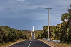 Rural road leading to a lighthouse in Australia. Stock Photos
