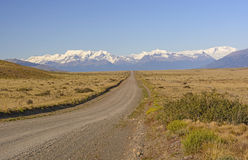 Rural Road Leading to the Mountains. In the Argentinian Patagonia Royalty Free Stock Images