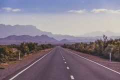 Rural road leading to the mountains. Rural road leading to the mountains in South Australia outback Stock Photo
