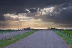 Rural road is leading to spectacular cloudscape Stock Photo