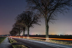 Rural road. In the moonless starlit night Stock Photography