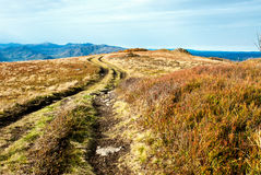 Rural road mountains. Rural road to horizont in mountains Stock Images