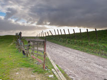 Rural road over a dutch dike Royalty Free Stock Photos