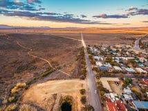 Rural road passing through Hawker. Rural road passing through Hawker - town in South Australia at sunset royalty free stock image