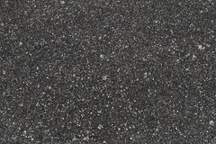 Rural road pavement, dark rough asphalt. Concrete. Seamless flat background texture, top view Royalty Free Stock Image