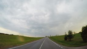 Rural road and the rain clouds stock video
