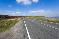 Rural A640 road running through rugged Yorkshire Moorland Stock Photo