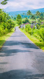 Rural road in Sediment District, Bali Island, Indonesia Royalty Free Stock Images