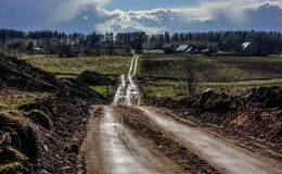 Rural road shine. Sun after rain Royalty Free Stock Photo