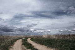 Rural road and sky Stock Photos
