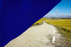 Rural road in soria. Behind a blue backdrop Stock Photos