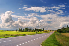 Rural road on sunny summer day Royalty Free Stock Photos