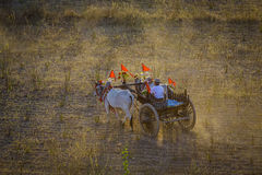 Rural road at sunset in Bagan, Myanmar. An ox cart runs on the rural road in Bagan, Myanmar. Bagan is an ancient city in central Myanmar formerly Burma Royalty Free Stock Images
