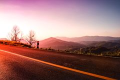 Rural road with sunset,nature landscape background. Beautiful view rural road with sunset in mountain,nature landscape background Royalty Free Stock Image