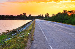 Rural road sunset Royalty Free Stock Images