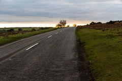 Rural road at sunset. Stock Images