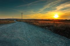 Rural road at sunset. View of a rural road at sunset, beautiful orange colors at the horizon Stock Photography