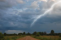 Rural road to storm sky Royalty Free Stock Images