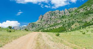 Rural road to Valley of Ghosts in Crimean mountains Stock Photos