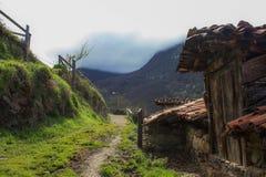 rural road towards the mountains stock photos