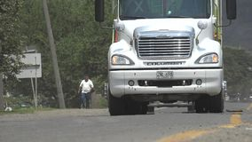 Rural road traffic in Colombia. Rural road and traffic in Colombia stock video