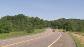 Rural road with trees on either side (3 of 3) stock video footage
