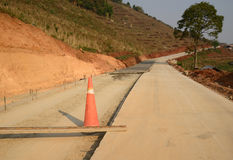 Rural road under construction. Rural road under construction in mountain Royalty Free Stock Photo