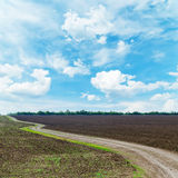 Rural road under dramatic sky Royalty Free Stock Image