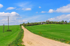 Rural road in village Stock Images