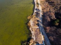 Rural road by the water aerial view. Rural road by the water aerial landscape view, lake, background, outdoor, top, green, nature, forest, above, scenic stock photography