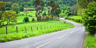 Rural road. A winding rural road in Northumberland, England Stock Photography