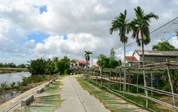 Rural road with wooden houses in Hoi An, Vietnam Royalty Free Stock Photography