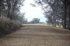 Rural road work. Roadwork on rural road. Australia. Dirt road royalty free stock photo