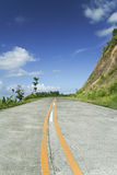 Rural road yellow lines blue sky philippines Stock Images