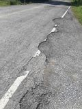 The rural roads deteriorate. The damaged roads in rural areas that require repair Stock Photos