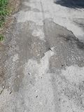 The rural roads deteriorate. The damaged roads in rural areas that require repair Royalty Free Stock Photos