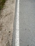 Rural roadside, asphalt and continuous white line stock image