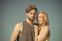 Rural romance. Love and romance. Relations of happy family, future. Muscular men and women with long blond hair, love. Family couple of men and sexy girl Royalty Free Stock Image