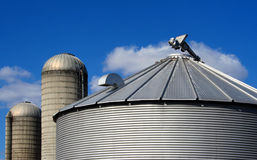 Rural Rooftops. Silos and Grain Bin Roof on farm royalty free stock photos
