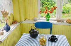 Rural room and ceramic tea set calendula on table. Rural room harmony and black ceramic tea set with dried calendula on table stock photos