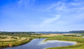 Rural Russian landscape. Sorot river coasts. Empty rural Russian landscape. Sorot river in the summer day Royalty Free Stock Photo