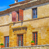 Rural sandstone house with shutter windows in  Saint-Paul de Ven Royalty Free Stock Images