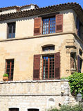 Rural sandstone house with wood shutters, Provence, France Royalty Free Stock Image